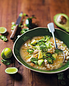 Mexican soup with white corn, chicken and avocado