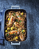 Sausages with braised lentils, lemon and green olives