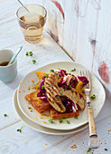 Warm radicchio and orange salad with porccini mushrooms and polenta