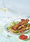 Chicken skewers with couscous and a brandy-tomato sauce