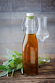 Sage liqueur in a flip-top bottle
