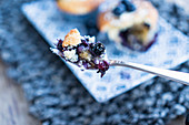 A piece of a blueberry muffins on a fork