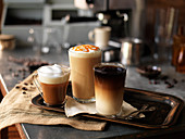 Various coffee drinks on a tray
