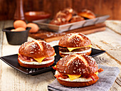 Lye bread rolls with bacon, cheese and fried egg