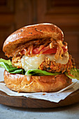A classic tofu burger with cheese and onions