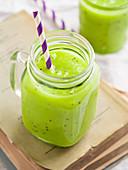 Vegan green smoothie (kiwi, avocado and melon)