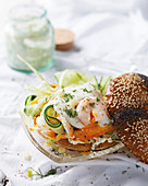 A bagel with marinated haddock and cucumber and egg