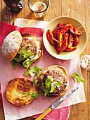 Lamb burgers and patatas bravas
