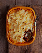 Cottage Pie in Baking Dish with Serving Spoon