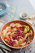 Carrot, celeriac and apple salad with pomegranate seeds, lime juice and seeds