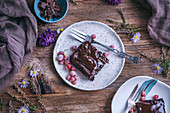 Chocolate sweet potato brownies served on dessert plates on rustic wooden table