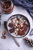 Chia pudding with homemade chocolate hazelnut spread topped with nuts and cacao nibs