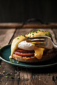 Eggs benedict on a rustic wood surface