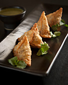 Vegetable samosas with a yoghurt and coriander dip