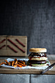 A double portobello burger with sweet potato fries (vegan)