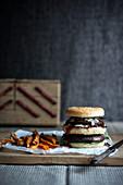 A double portobello burger with sweet potato fries (vegan)