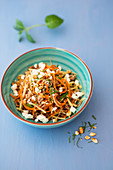 Carrot and parsnip noodles with minced meat, mint and feta cheese