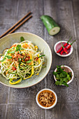 Papaya noodles with mango, coriander and roasted onions (vegan)