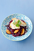 Beetroot noodles with zander fillet and orange fillets