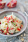 Celeriac salad with apples, cashew nuts and pomegranate seed (vegan)