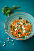 Sweet potato spaghetti with chilli, feta cheese and mint
