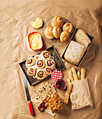 Various light coloured bread, cakes and biscuits