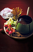 Chocolate fondue with fruit and salted bread sticks