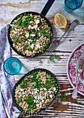 Barley risotto with peas, spring onions, feta cheese and lemons