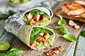 Salmon and guacamole wraps with bacon