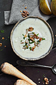 Parsnip soup with a walnut and pear topping