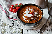 Vegan lentil and tomato soup with coconut milk