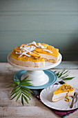 Coconut and mango cheesecake with fresh passion fruit and mango pieces, slice removed