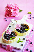 Blueberry tartlets with pink hydrangeas