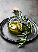 Olive oil with an olive sprig