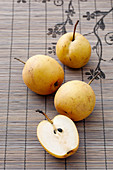 Nashi pears, whole and halved