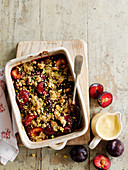 Plum crumble with vanilla sauce