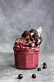 A blueberry and blackberry ice cream smoothie with chia seeds