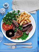 A fry up with chips and peas