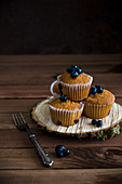 Blueberry muffins on a bark disc