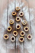 Christmas jam biscuits arranged in a tree shape on a wooden surface
