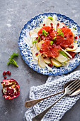 Fennel salad with apple, pink grapefruit and pomegranate seeds