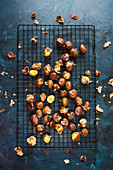 Roasted chestnuts on a cooling rack (seen from above)