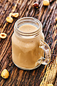 A protein shake with bananas, peanut butter and hazelnuts