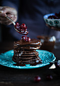 Chocolate pancakes with cranberry compote and chocolate sauce