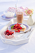 Warm caramel waffles with marinated strawberries and whipped cream