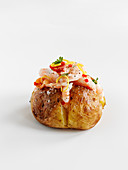 A baked potato with prawns, salmon and chilies