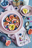 Muesli with figs, milk, passion fruit, blueberries and rose petals