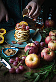 Pancakes with apple, honey, grapes, cinnamon and peach