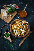 Penne with tomato sauce, pesto and Parmesan cheese
