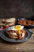 Baked beans on toast with a fried egg